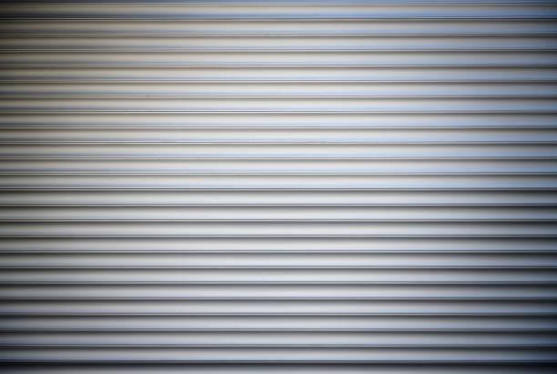 Rolling aluminum garage door stock photo