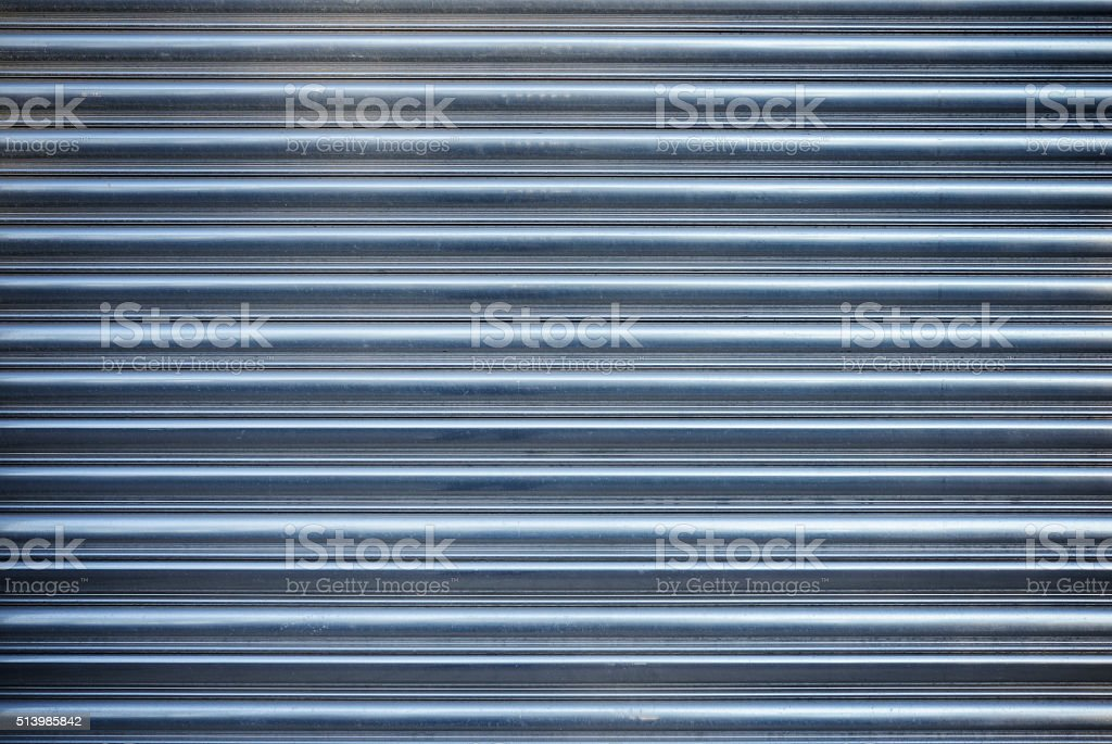 Rolling aluminum garage door stock photo