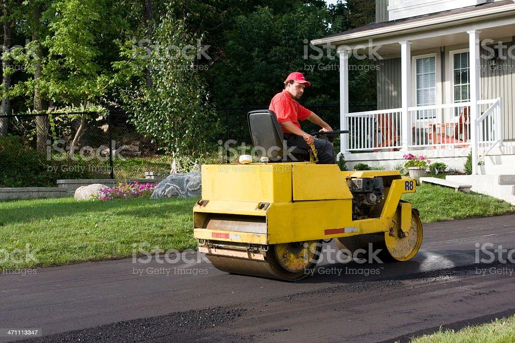 Rolling asphalt driveway stock photo
