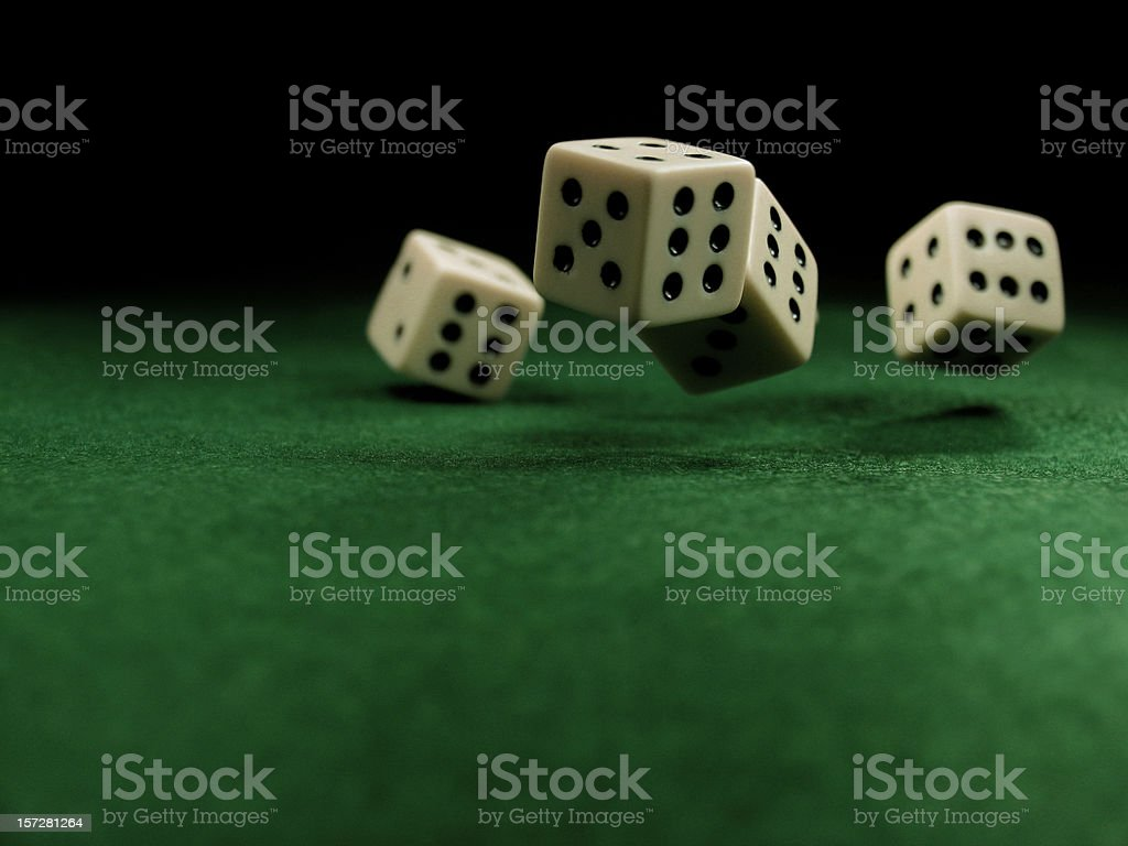 Rolling Dice on Felt Table royalty-free stock photo