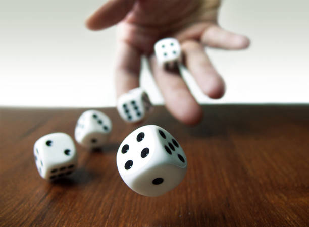 Rolling Dices Rolling Dices game of chance stock pictures, royalty-free photos & images