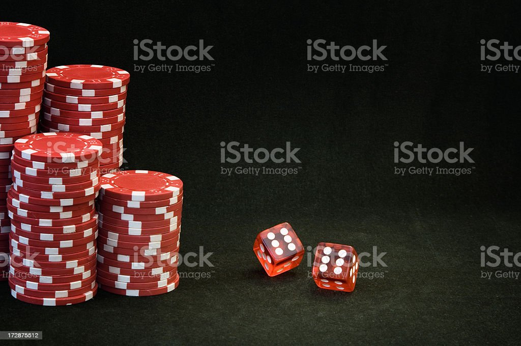Rolling dices with red chips royalty-free stock photo