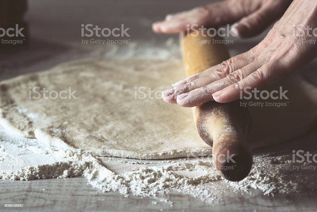 Rolling dough for calzone stock photo