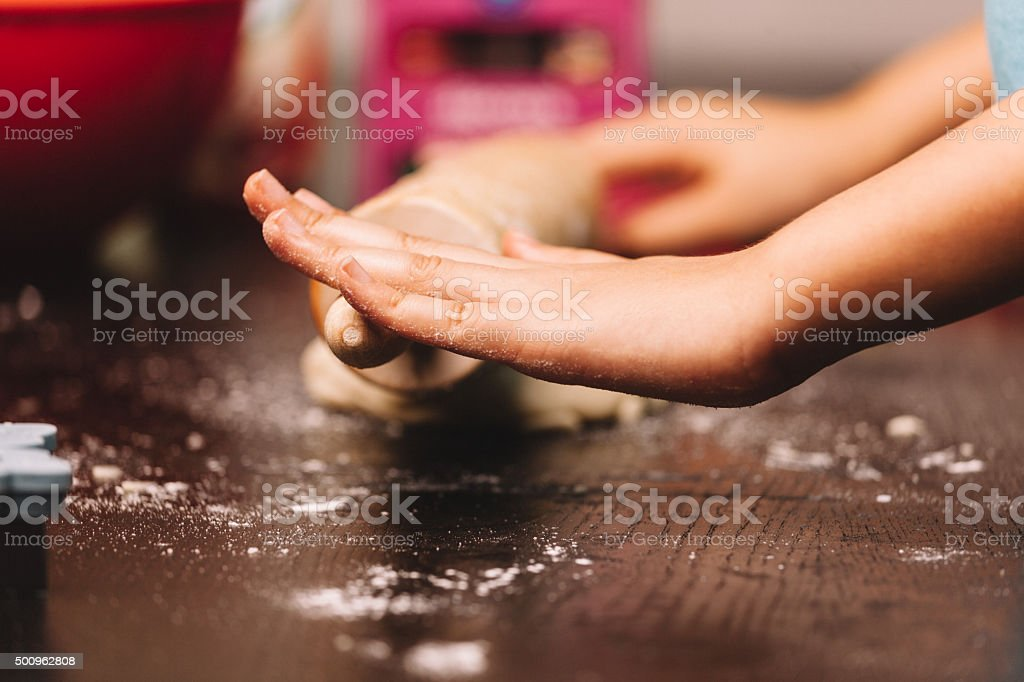 rolling dough for cookies stock photo