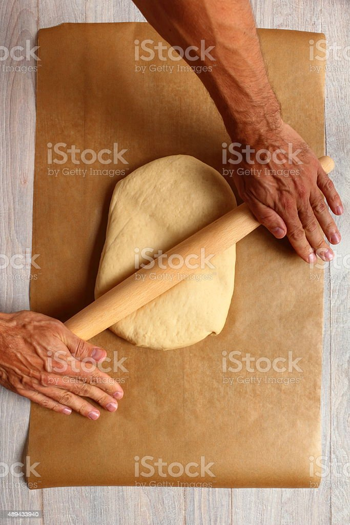 Rolling Dough. Making Meat Pie from Yeast Dough. stock photo