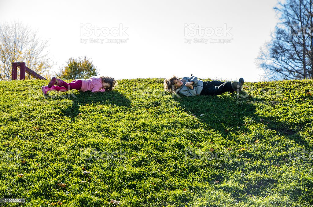 Rolling down the hill stock photo