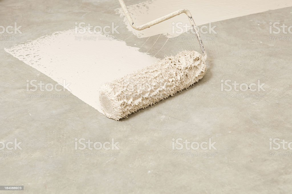 Rolling Epoxy Paint on Concrete Floor royalty-free stock photo