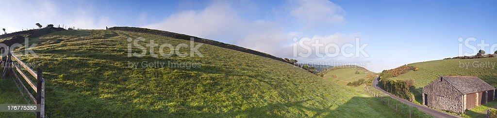 Rolling hills in Devon, panoramic farmland. stock photo