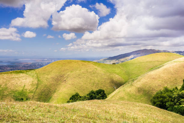 Rolling hills in south San Francisco bay area; east San Francisco bay area visible in the background; San Jose, California Rolling hills in south San Francisco bay area; east San Francisco bay area visible in the background; San Jose, California san francisco bay stock pictures, royalty-free photos & images