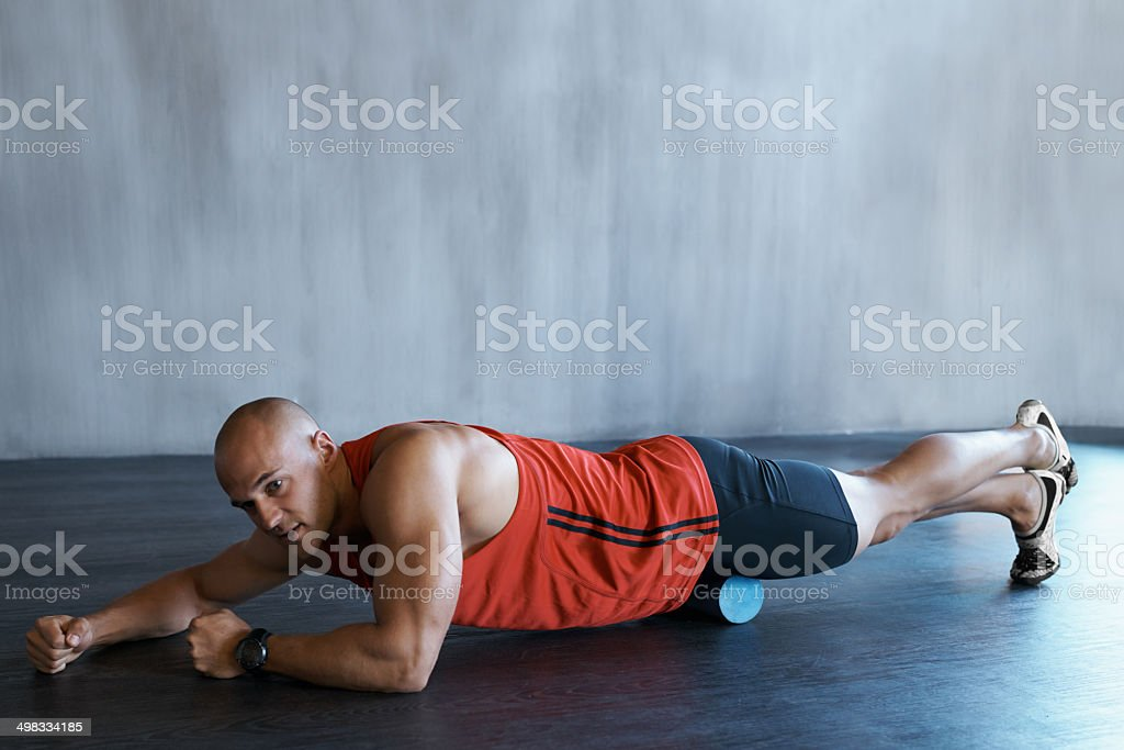Rolling his way to fitness royalty-free stock photo