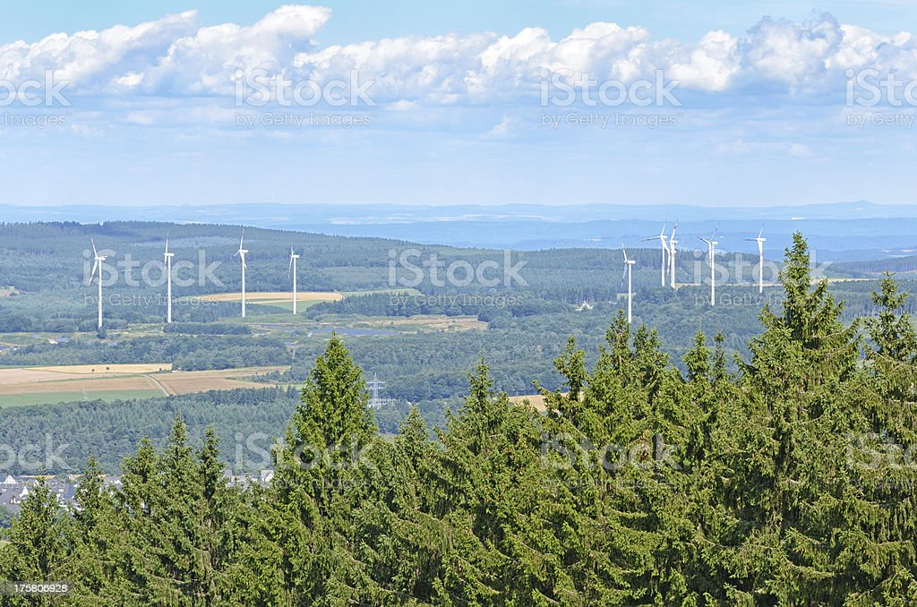Rolling landscape with wind turbines in background royalty-free stock photo