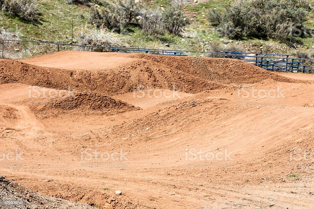Rolling mounds of a dirt bicycle motocross course stock photo