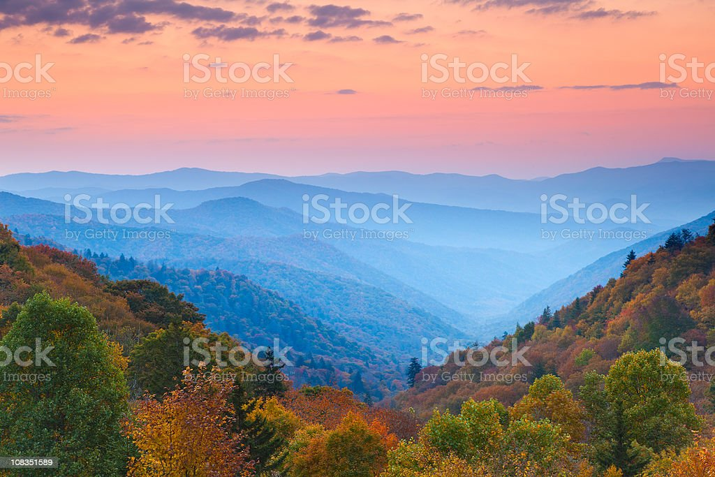 Rolling Mountain Ranges at Sunrise stock photo