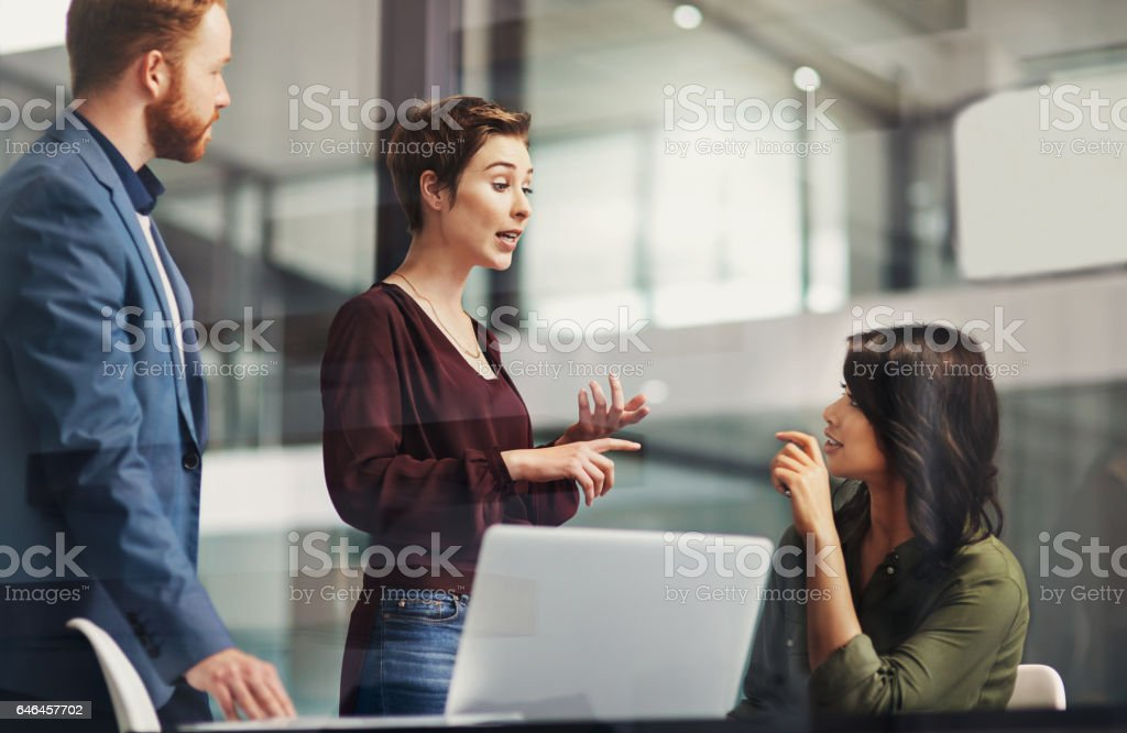 Rolling out a plan of action to the team stock photo