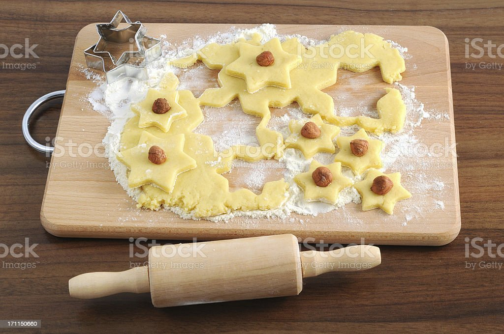 rolling pin and star shape pasty cutter on dough royalty-free stock photo