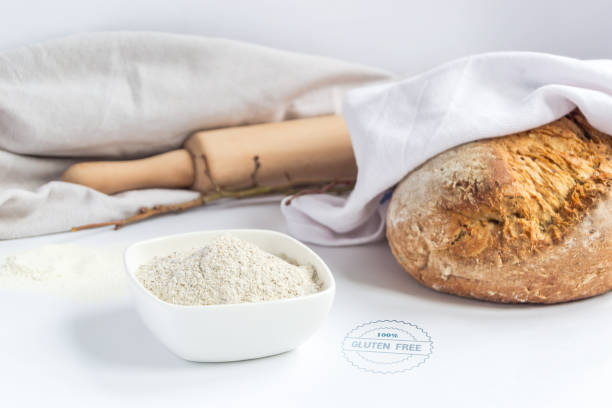 Rolling pin, flour and bread stock photo