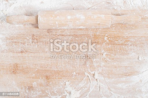 istock Rolling pin on a wooden tray covered with flour 511464008