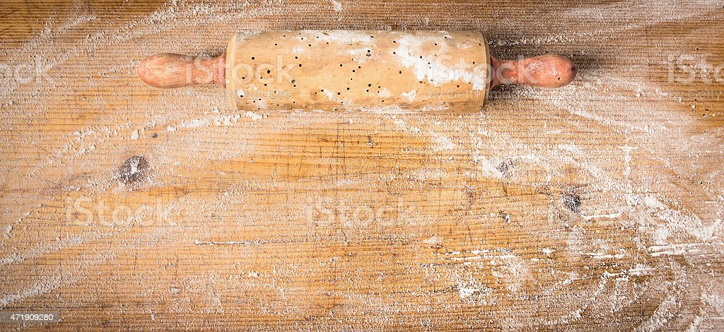 Rolling pin on old wooden background with  wheat flour, banner stock photo
