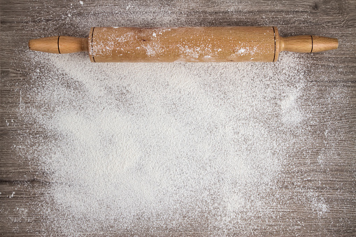 istock Rolling Pin on Woooden Floured Background 477076984