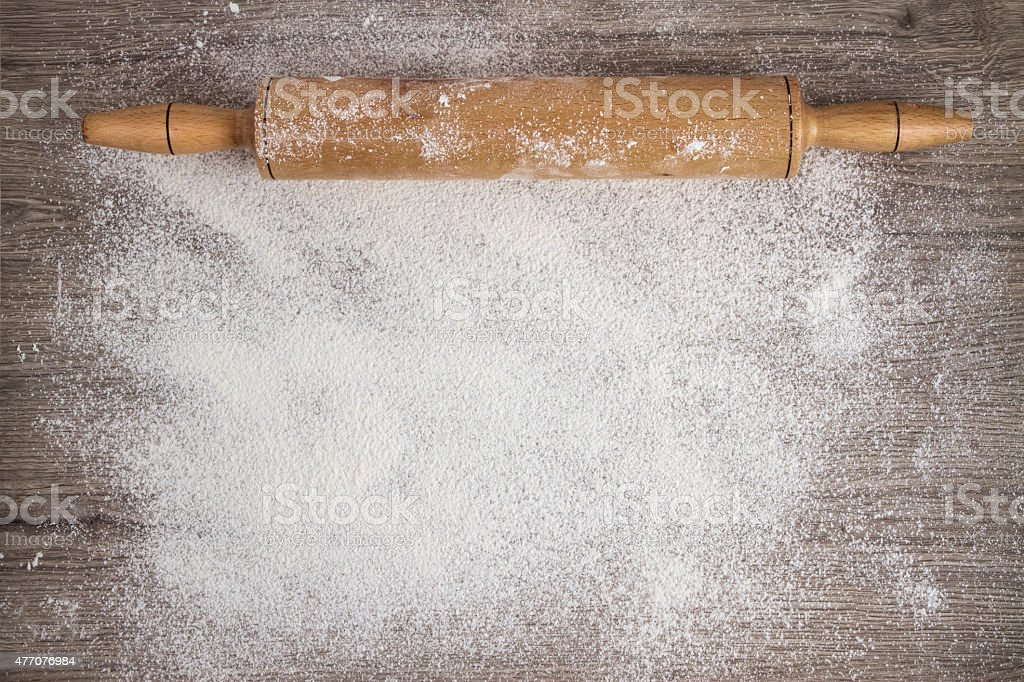 Rolling Pin on Woooden Floured Background stock photo