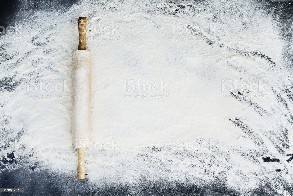Rolling Pin Over Flour Background stock photo