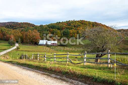 488912426istockphoto Rolling rural landscape in Vermont on a cloudy autumn day 1199738686