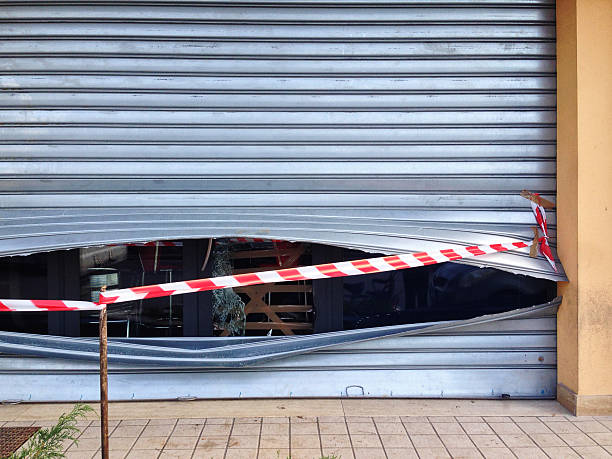 Rolling shutter smashed and shop robbed - Burglary stock photo