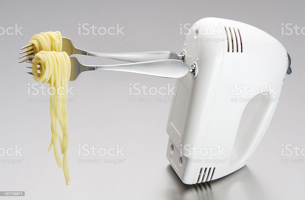 Rolling spaghettis the fast way stock photo