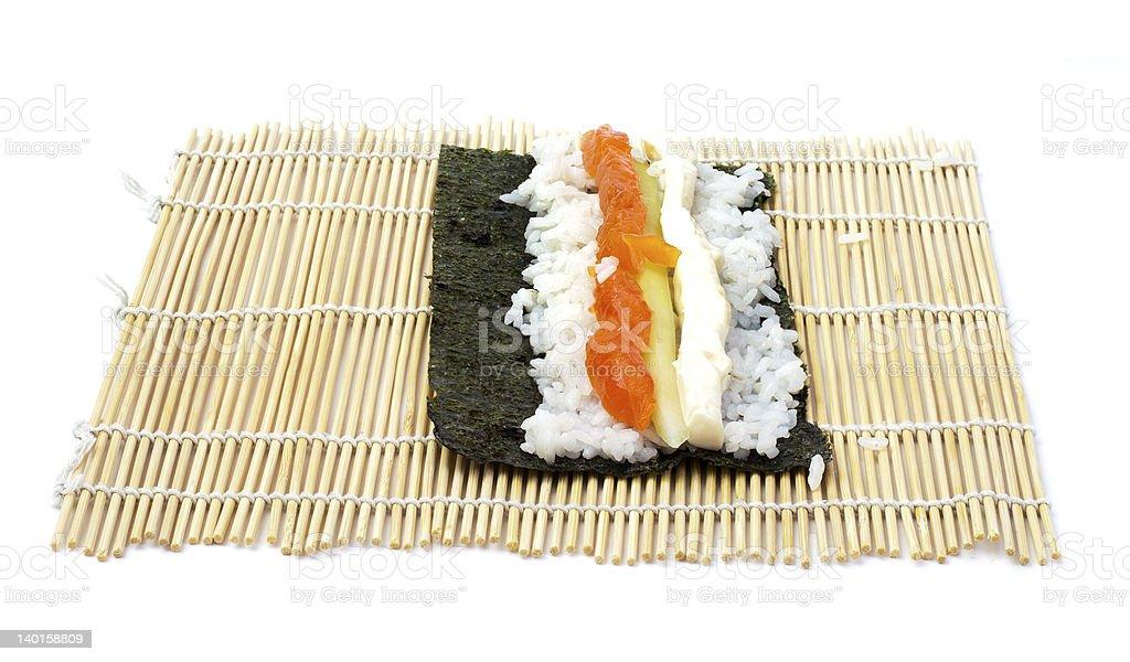 rolling sushi maki royalty-free stock photo