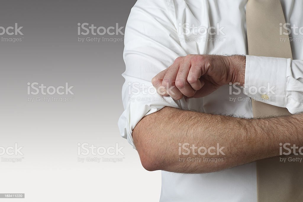 Rolling Up  Sleeves stock photo