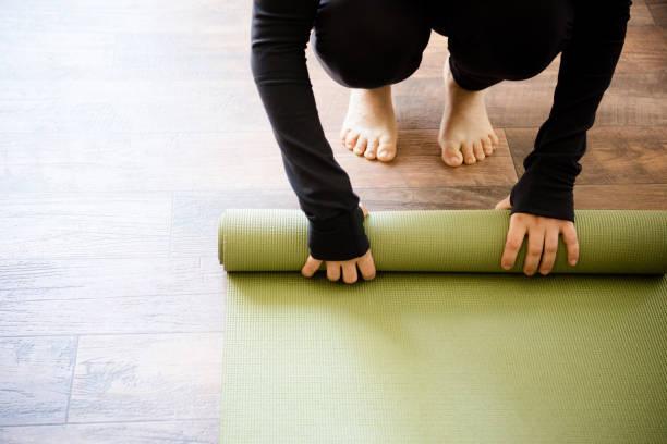 Yoga-Matte aufrollen – Foto