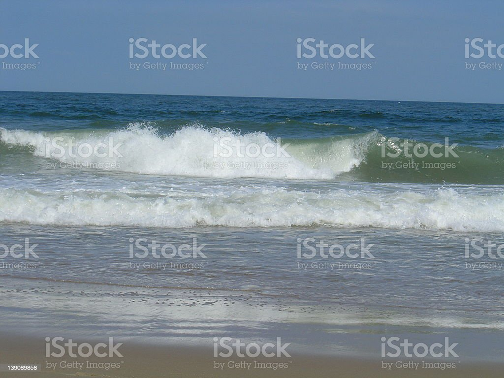 Rolling waves at the beach royalty-free stock photo