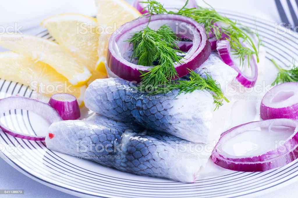 Rollmops on a plate stock photo