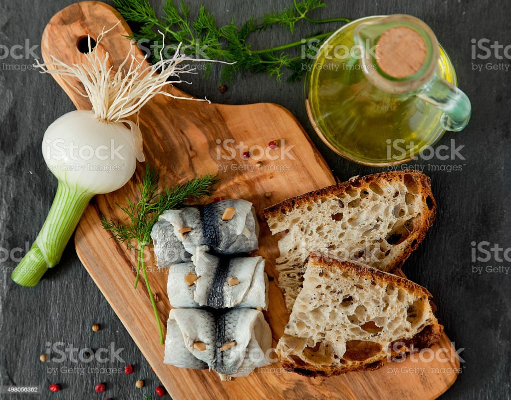 Rollmops - pickled herring fillets stock photo
