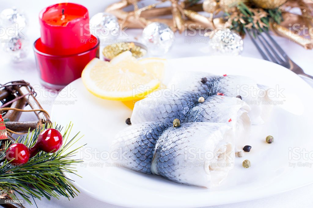 Rollmops with lemon for Christmas stock photo