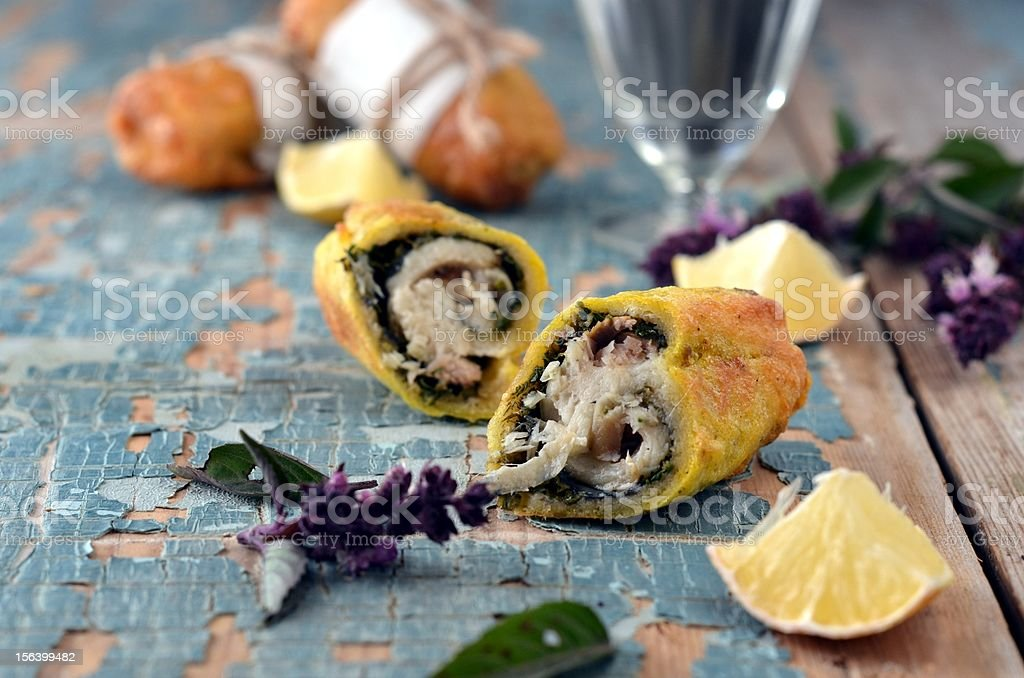 Rolls baked fish and pesto sauce royalty-free stock photo
