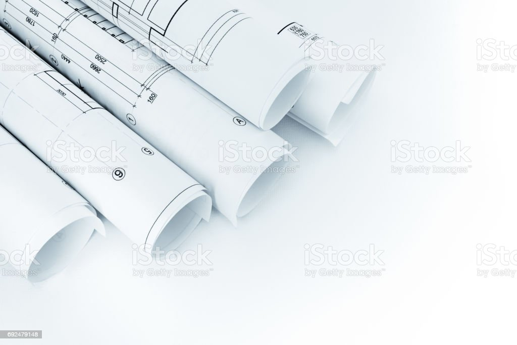 Rolls Of Architectural House Floor Plans On White Background Stock