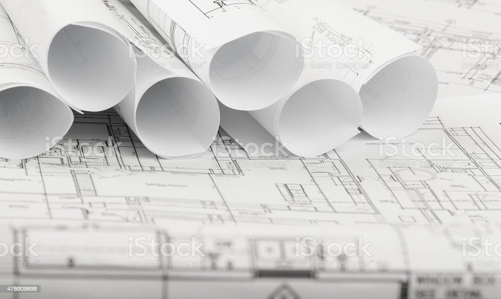 Rolls of architecture blueprints and house plans stock photo more rolls of architecture blueprints and house plans royalty free stock photo malvernweather Images
