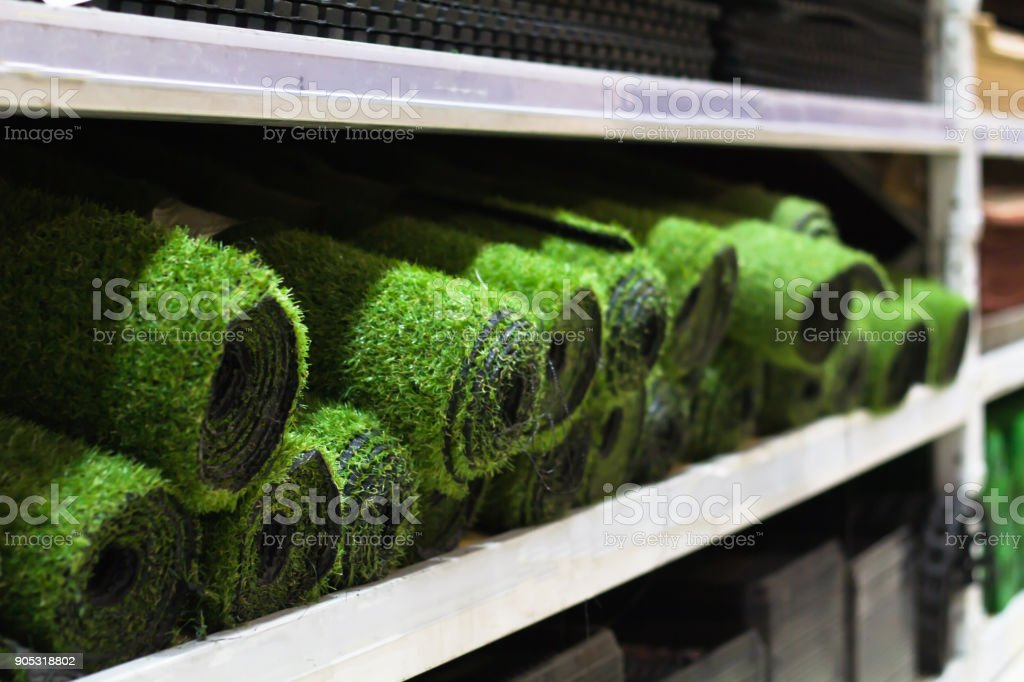 Rolls of artificial grass sale on the shelf stock photo