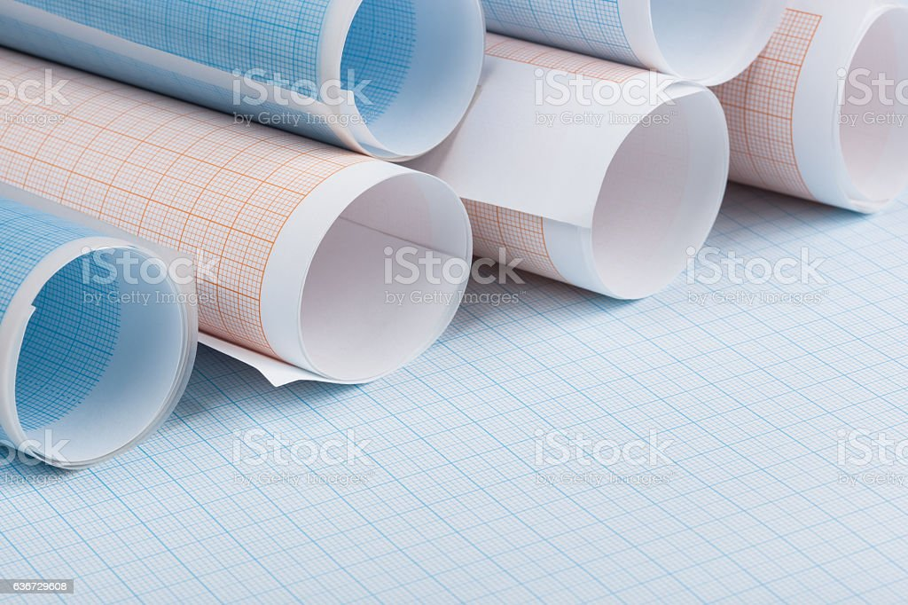 rolls of blue and orange graph paper stock photo istock