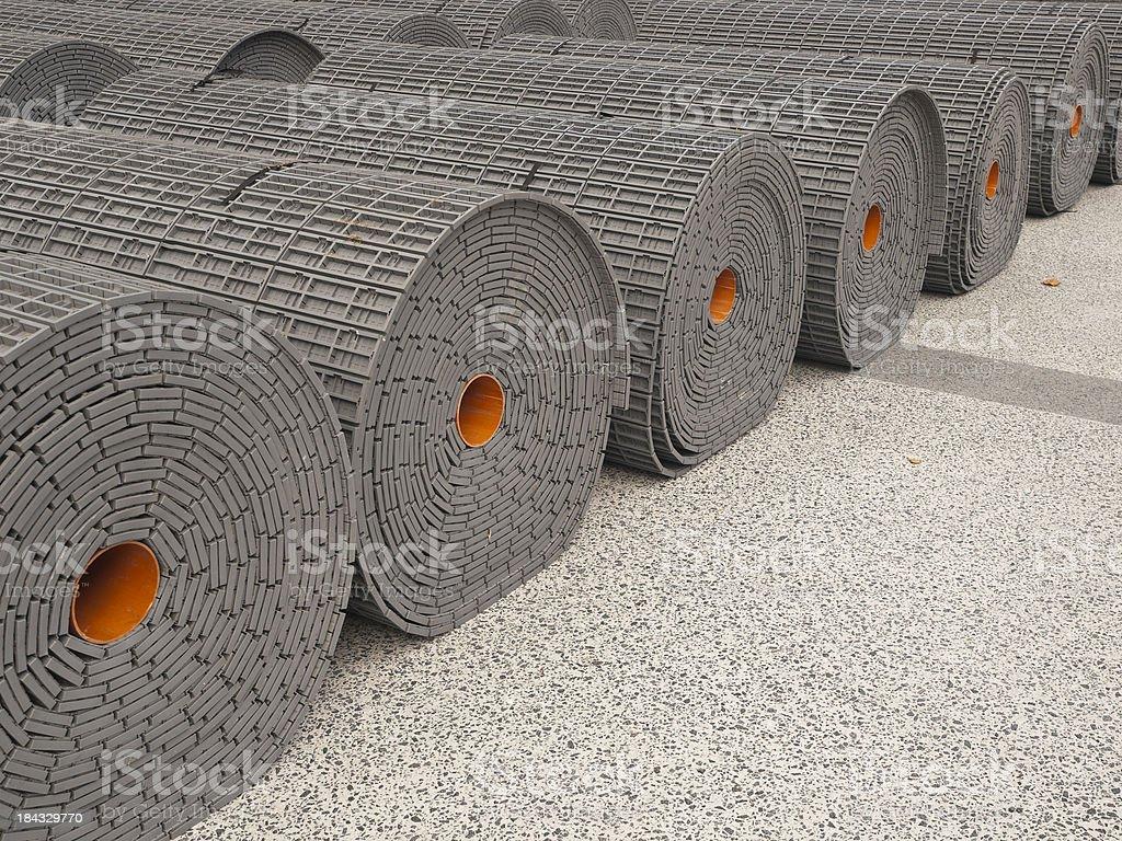 Rolls of carpet outside stock photo