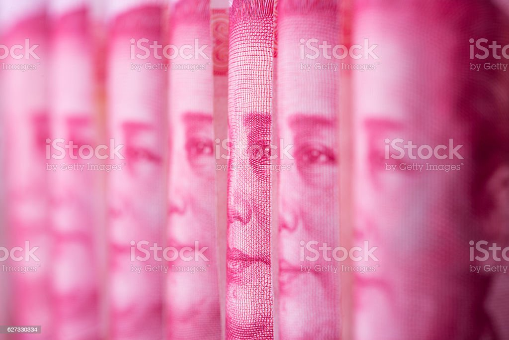 Rolls of Chinese one hundred 100 RMB Yuan banknotes stock photo