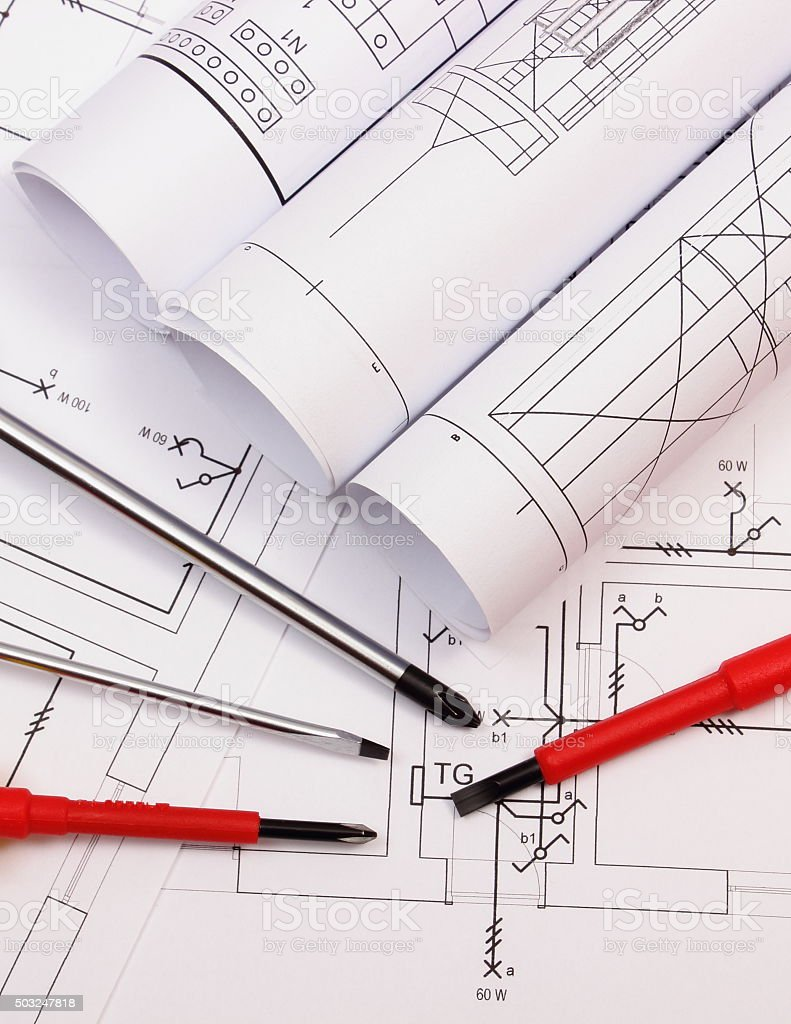 Rolls Of Diagrams And Work Tools On Electrical Construction Drawing Stock Photo Download Image Now Istock