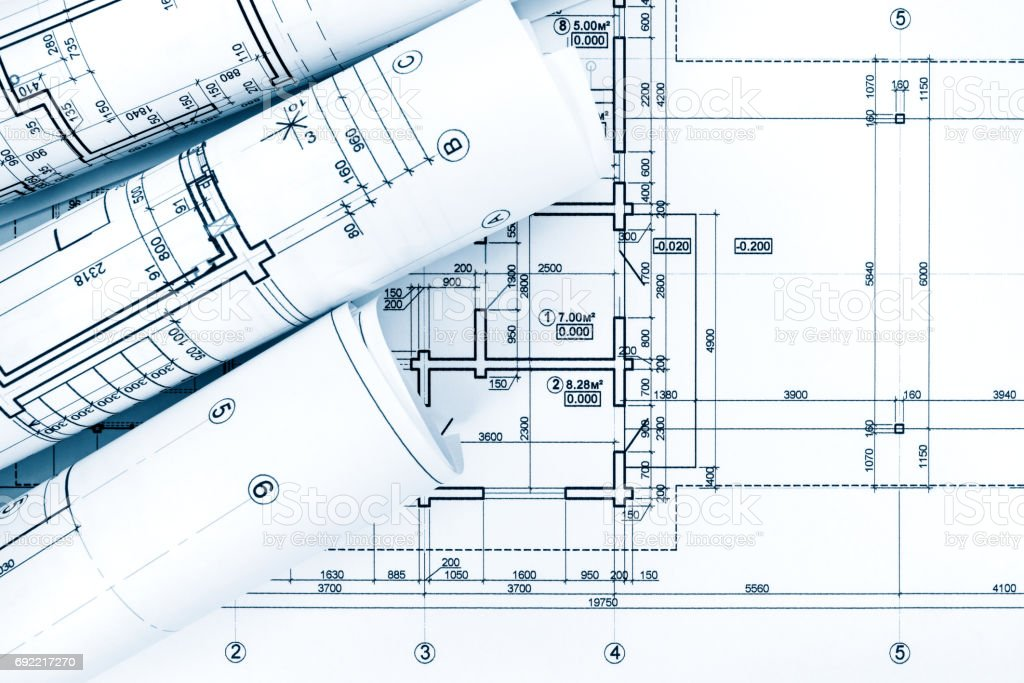 Rolls of drawing paper with architectural project plans on blueprint rolls of drawing paper with architectural project plans on blueprint royalty free stock photo malvernweather Gallery