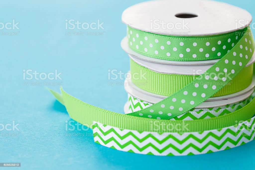 Rolls of gift ribbon stacked stock photo