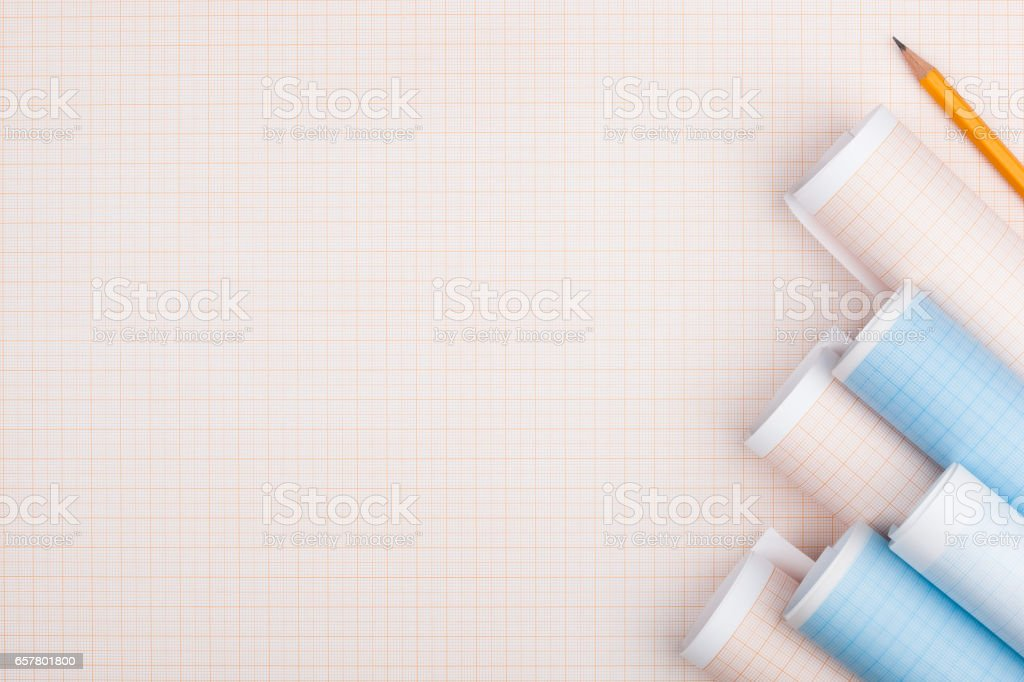 Rolls of graph paper and pencil. – zdjęcie