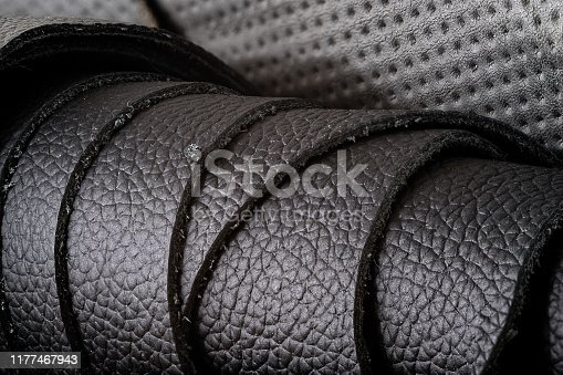 istock Rolls of leather, dark and lighter colors, closeup with lots of texture 1177467943