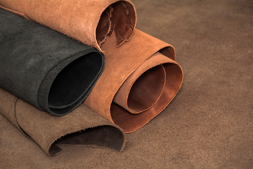 istock Rolls of natural brown and black leather. Materials for leather craft 937009366