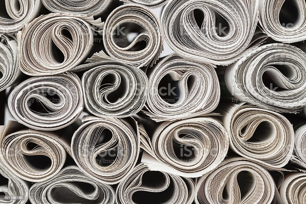 Rolls of newspapers. stock photo