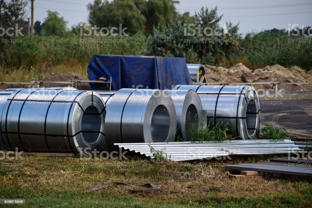 Rolls of sheet metal. Storage of building materials stock photo